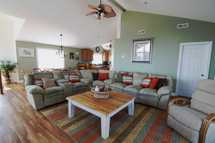 Large living room area accommodates all guests comfortably.