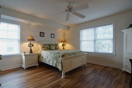 Bedroom with queen bed and private bath.