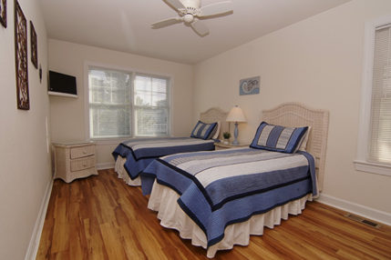 Bedroom with two twin beds and shared bath.
