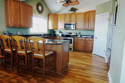 Kitchen with walk in pantry is well stocked with cooking utensils and appliances.