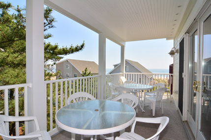 The balcony off the family room provides a great area to enjoy a casual meal or an afternoon drink.