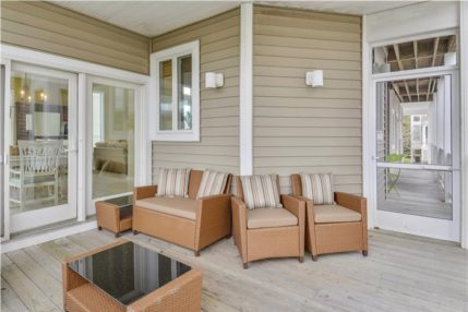 Screened-in porch with seating for eight.