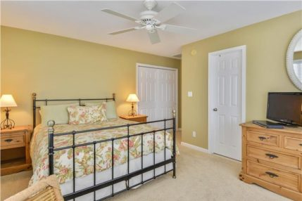 The fourth bedroom has a queen size bed and shares a bathroom with the third bedroom.