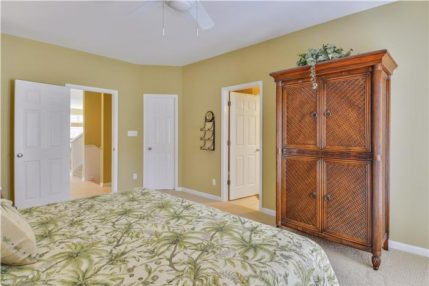 The master bedroom has a private bath, walk-in closet and balcony.